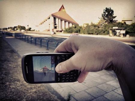 taking photo: Taking photo with smartphone.