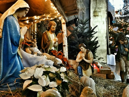 creche: Christmas crib with child Jesus, father Josef and virgin Mary in stable at Gdansk.