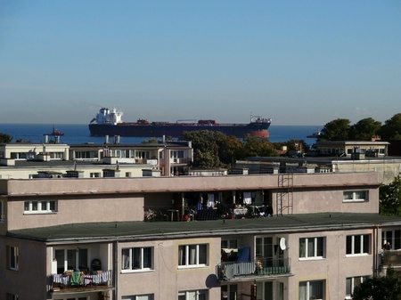 multimodal: View from my window. Ship enter to the port. Gulf of Gdansk. Baltic Sea. Gdansk Brzezno, Poland. Stock Photo