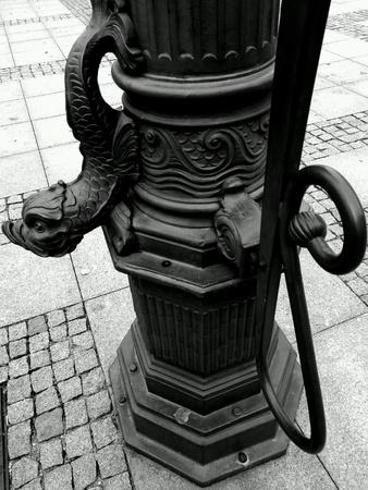 pomp: Historic water pomp detail on the maket square. Sightseeing Chelmno, Poland.