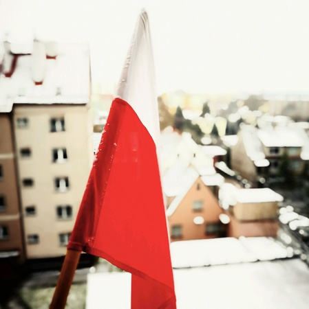 Independents day in Poland. Polish National flag in snow.