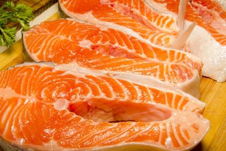 salmon steaks on a chopping board Stock Photo - 11191161