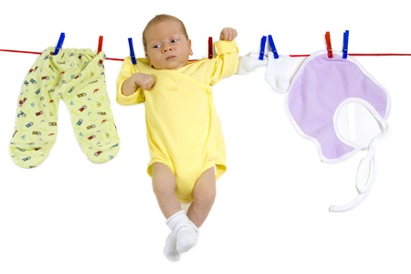 Baby hanging on the clothesline Stock Photo