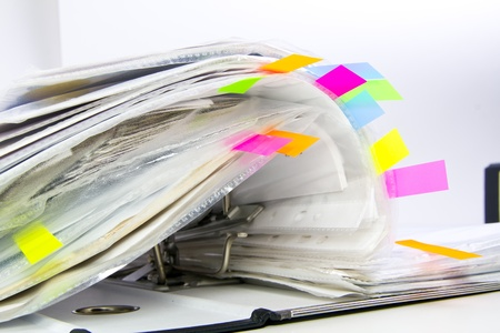 files with colored markers  bookmarks  in the opened office folder
