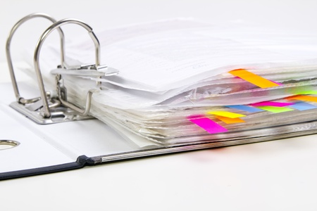 Files with colored markers  bookmarks  in the opened office folder Stock Photo - 13042022