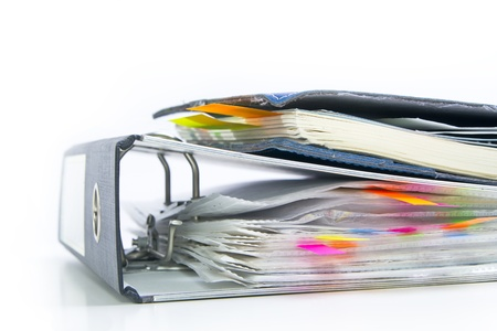 files with colored markers  bookmarks  in the office folder and notepad