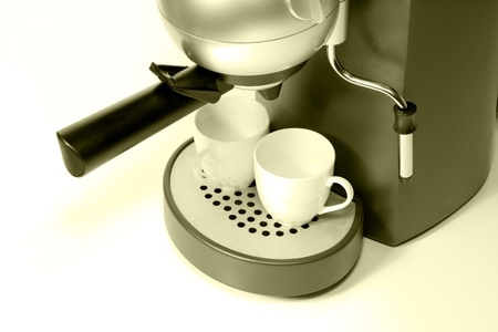two white cup of espresso and coffee maker Stock Photo