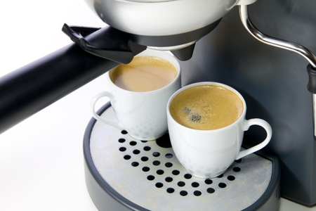 two white cup of espresso and coffee maker photo