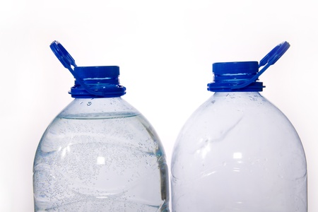Couple of blue five liter bottles of water (full and empty) Stock Photo