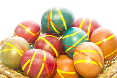 Multi-colored Easter eggs in a wicker tray  dish