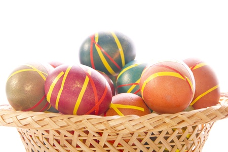 Multi-colored Easter eggs in a wicker tray  dish