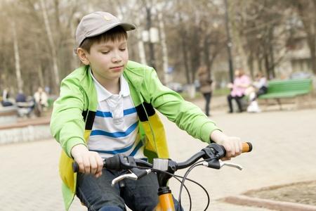 boy riding on the orange bike on the street Stock Photo - 13471714