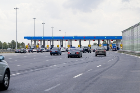 toll: gate with barriers by toll road on the highway
