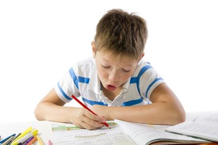 child making the homework isolated on white