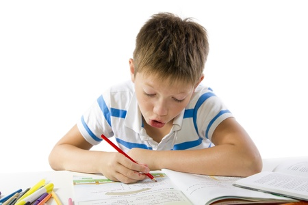 child making the homework isolated on white photo
