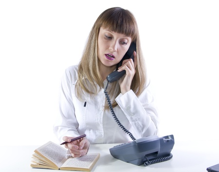 Business woman speaking on the phone while working with documents photo