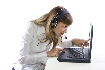 Beatiful Woman with headphone working on laptop Stock Photo