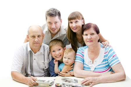 Happy family looking photo album together photo
