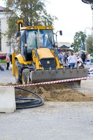 The heavy bulldozer of yellow color construction pavement photo