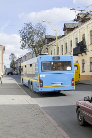 Blue bus on the street in old European city