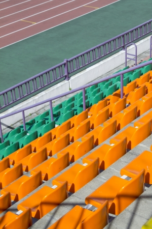 rows of plastic seats at modern stadium Stock Photo