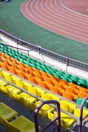 rows of plastic seats at modern stadium photo