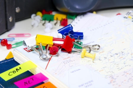 Colored pushpins on the notebook close up
