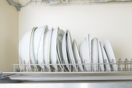 white dishes (plates) in the modern cupboard