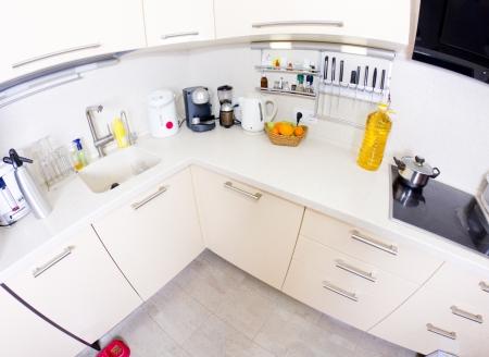 View of a modern kitchen (fish-eye shot) Stock Photo