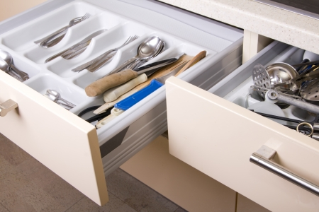 drawers: Open Organized Kitchen Drawer with utensils Stock Photo