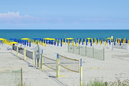 Volleyball nets and umbrellas on the beach