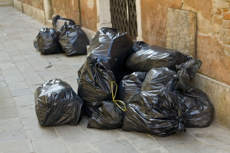 Garbage bags on the street photo