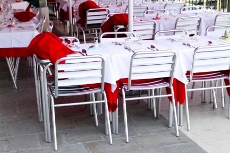 Empty tables of sidewalk cafe in Italia Stock Photo