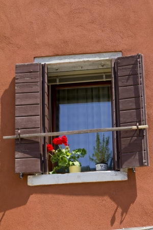 Windows and old wooden shutters photo