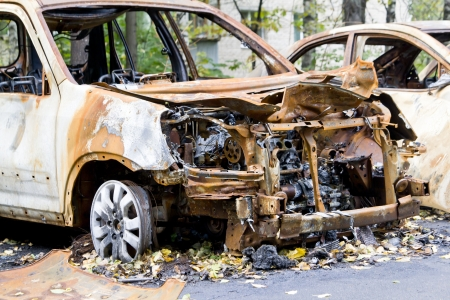 Burned car after terror attack Stock Photo