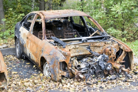 Burned car after terror attack Foto de archivo