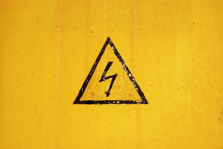 high voltage sign on ragged background photo