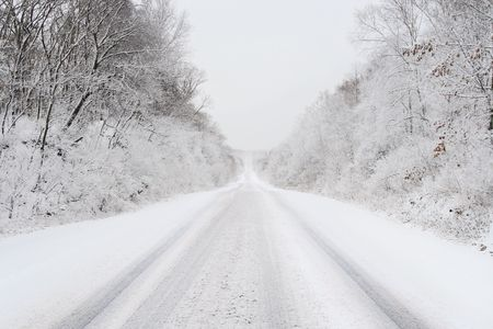 snow covered country road in february