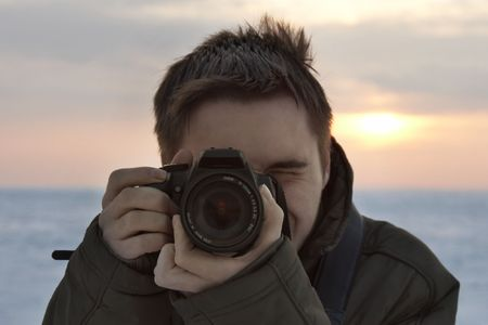 professional photographer with dSLR while working Stock Photo