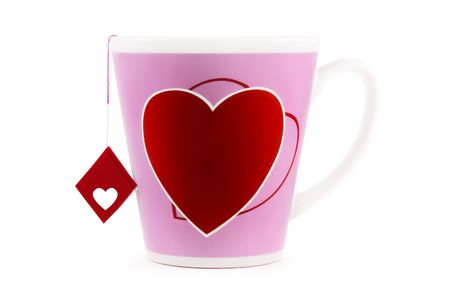 shot of the big cup with heart print and tea-label with symbol of love, on a white background with pretty shadow Stock Photo
