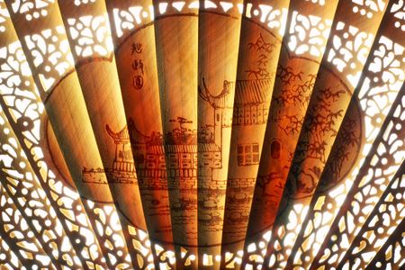 extreme close-up of oriental art on unfolded traditional chinese fan
