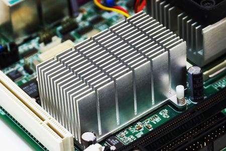 extreme close-up of aluminum radiator installing on motherboard chipset