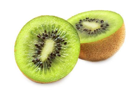 hairy pear: macro shot of sliced open kiwi fruit on a white background with pretty shadows