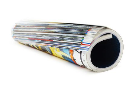 shot of the magazine roll (Shallow DOF) on a white background with pretty shadow Stock Photo