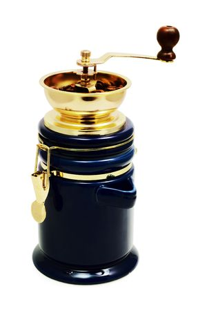 classic coffee grinder with coffee grains on a white background