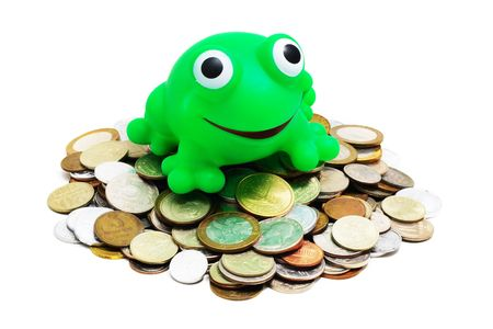 heaps of various coins and crazy frog (concept - greedy for money) on a white background