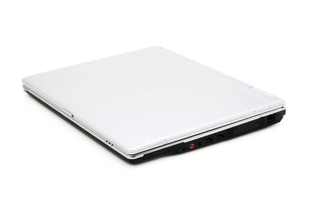 plainness: closed silver laptop on a white background with pretty shadow Stock Photo