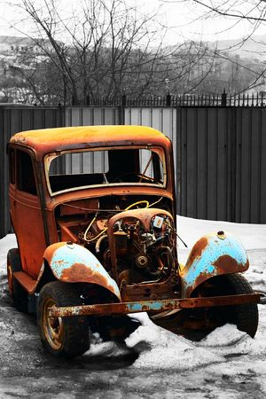 rusty vintage car of an epoch of 1940s