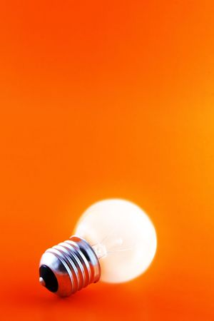 glowing light bulb on a red background with copyspace Stock Photo