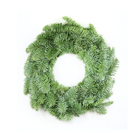 christmas wreath made from real pine boughs isolated on white background photo